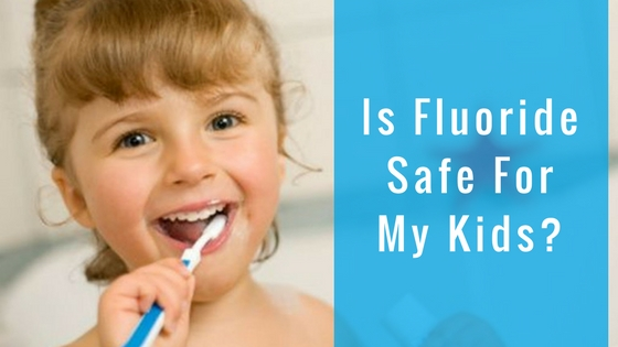 child brushing safely with fluoride toothpaste