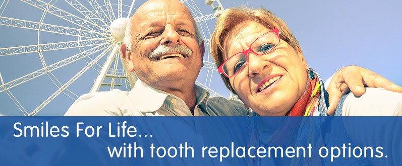 smiling couple who replace missing teeth with dental crowns bridge